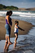Travel photography:Mother and child at a beach near Quiahuiztlan, Mexico