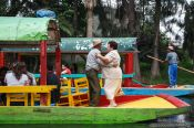 Travel photography:Dancing to the tune of the Mariachi on one of the colourful trajineras (rafts) on Lake Xochimilco, Mexico