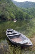 Travel photography:Small fisherman`s boat in Rijeka-Crnojevica, Montenegro