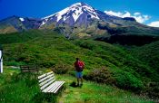Travel photography:Hiker with Mt Taranaki, New Zealand
