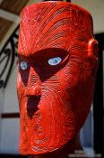Travel photography:Wooden sculpture at a Maori meeting house near Whanganui, New Zealand