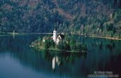 Travel photography:Island with church surrounded by Blejsko jezero (Bled lake), Slovenia