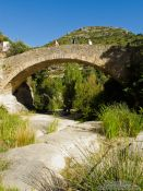 Travel photography:Old stone bridge at Cingles de Berti, Spain