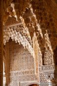 Travel photography:Arches in the Patio de los Leones (Court of the Lions) of the Nazrin palace in the Granada Alhambra, Spain