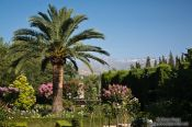 Travel photography:Park and gardens of the Generalife of the Granada Alhambra with the Sierra Nevada in the background, Spain