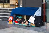 Travel photography:Homeless person on the Gran Via in Madrid, Spain
