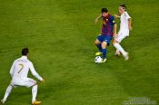 Travel photography:Tackle by Özil against Messi with Cristiano Ronaldo, Spain