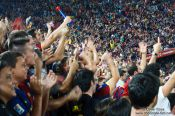 Travel photography:Spectarors celebrate the end of the game, Spain