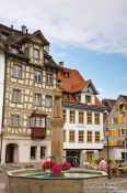 Travel photography:Houses with fountain in Sankt Gallen , Switzerland