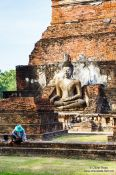 Travel photography:Man with Buddha at the Sukhothai temple complex, Thailand