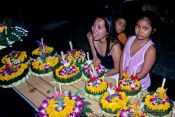 Travel photography:Selling the flower floats for the Loi Krathong festival., Thailand