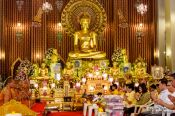 Travel photography:Buddhist monks with worshippers at Bangkok´s Wat Chana Songkram, Thailand