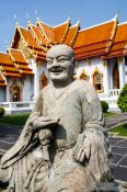 Travel photography:Buddha sculpture outside the marble temple Wat Benchamabophit in Bangkok, Thailand