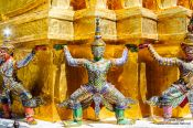 Travel photography:Golden demon sculptures at Wat Phra Kaew, the Bangkok Royal Palace, Thailand