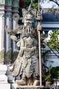 Travel photography:Stone guardian at Wat Pho temple in Bangkok, Thailand