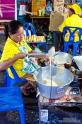 Travel photography:Preparing food at a street stall in Trang, Thailand