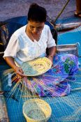 Travel photography:Assembling a basket in Trang, Thailand