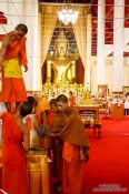 Travel photography:Yound monks decorating Wat Chedi Luang Worawihan in Chiang Mai, Thailand