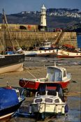 Travel photography:Fishing harbour and lighthouse in Cornwall, United Kingdom England