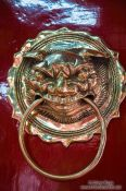Travel photography:Brass door knob at a Chinese assembly hall in Hoi An, Vietnam