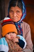 Travel photography:Hoi An grandmother with baby , Vietnam