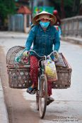 Travel photography:Hoi An woman on bike , Vietnam