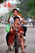 Travel photography:Kids riding a bike in Hue, Vietnam
