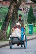 Travel photography:Hue man and woman on bike , Vietnam