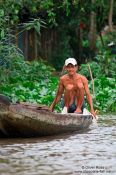 Travel photography:Man on boat in Can Tho , Vietnam