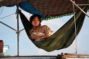 Travel photography:Having a rest aboard his ship near Can Tho, Vietnam