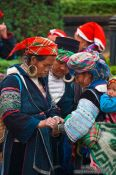Travel photography:Hmong women examining their handy work at the weekly market in Sapa , Vietnam