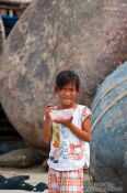 Travel photography:Girl with rice bowl in Mui Ne , Vietnam