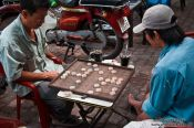 Travel photography:Two men playing in Hoh Chi Minh City, Vietnam